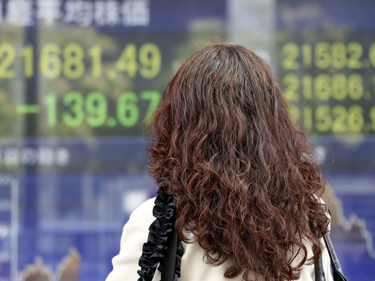 Global stocks slide as futures point to Wall Street drop