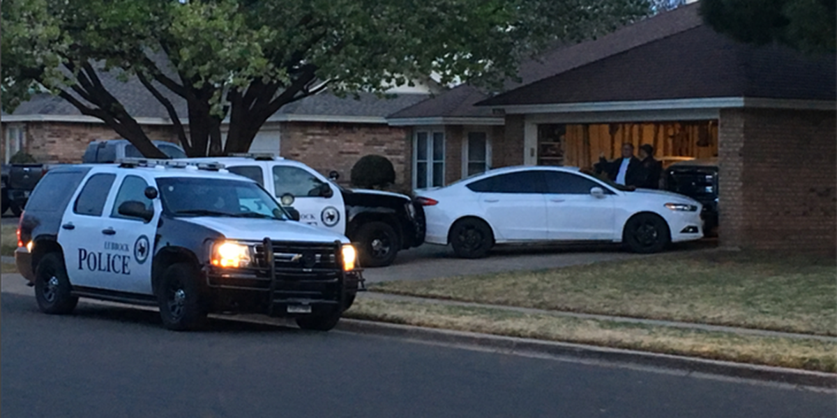 Woman arrested after running into home Sunday morning
