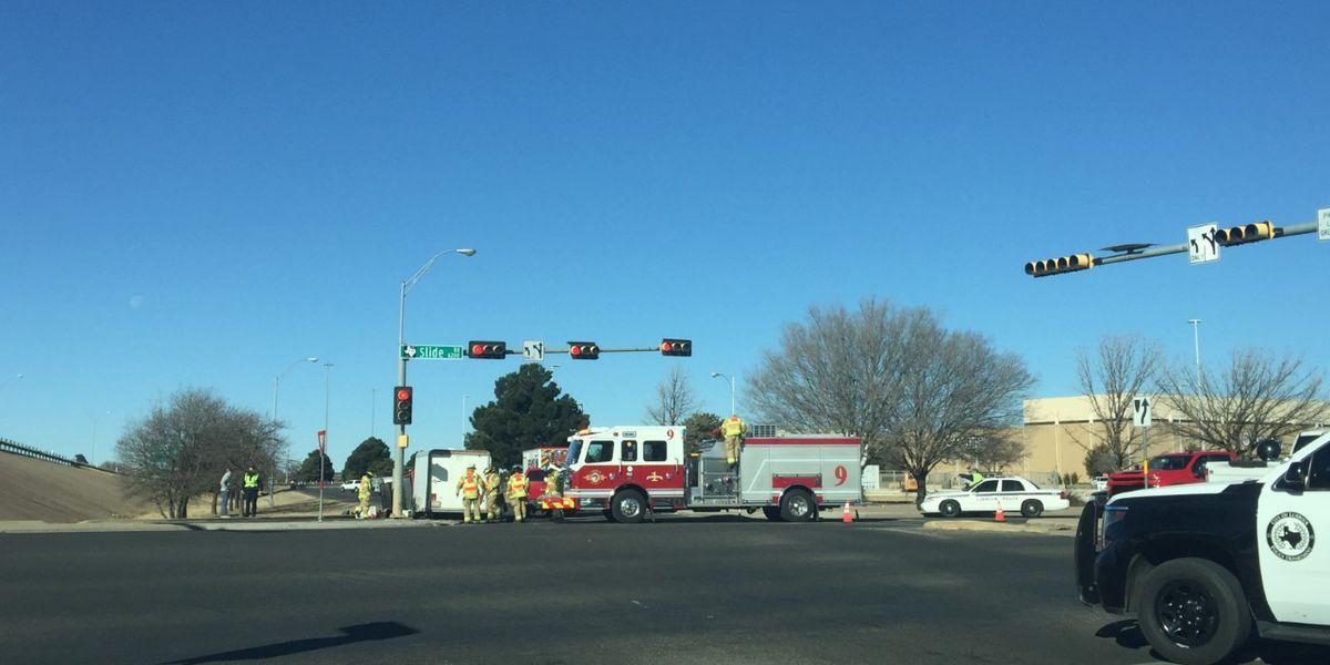 Crash at South Loop 289 and Slide Road blocking traffic