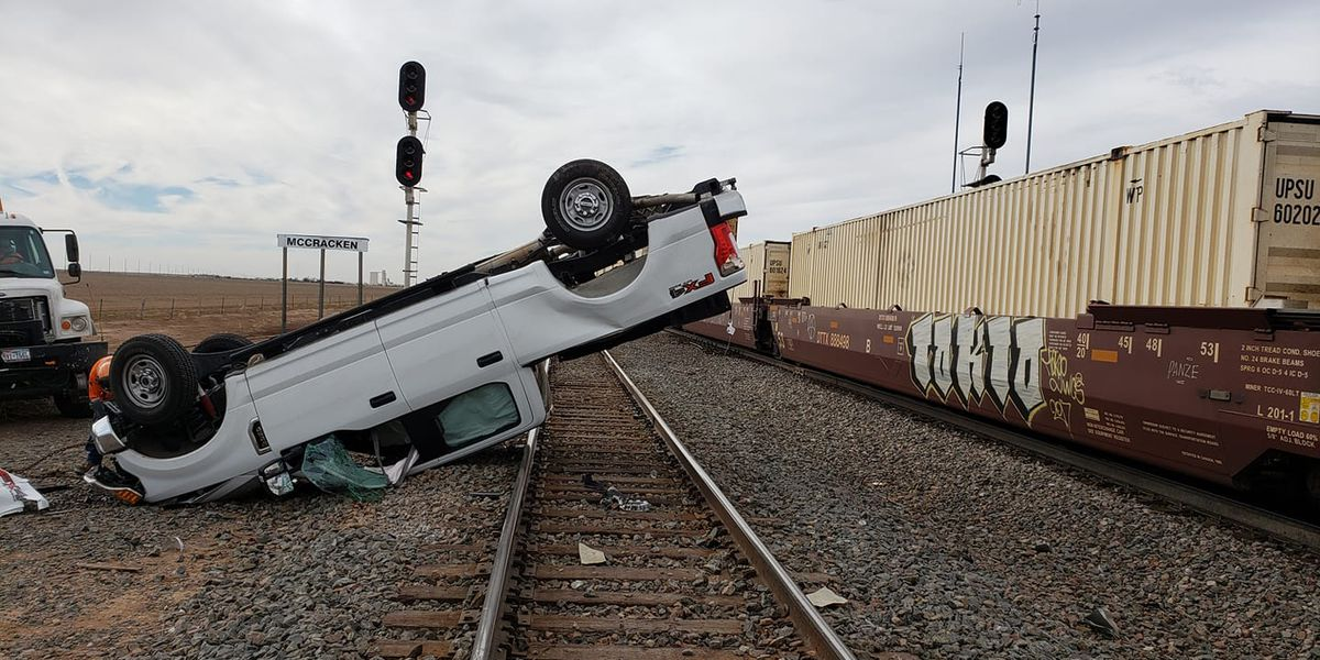 2 hospitalized after crash involving vehicle and train