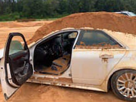 A Florida man used a tractor to dump dirt on a car, police said. His girlfriend was inside.