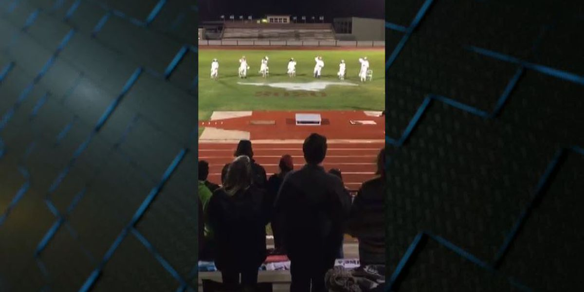 Football field split between two counties forces graduation on visitor's side