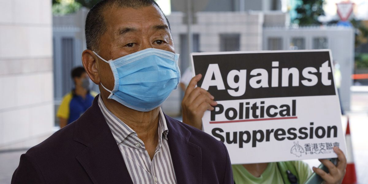 Hong Kong newspaper raided, tycoon detained under new law