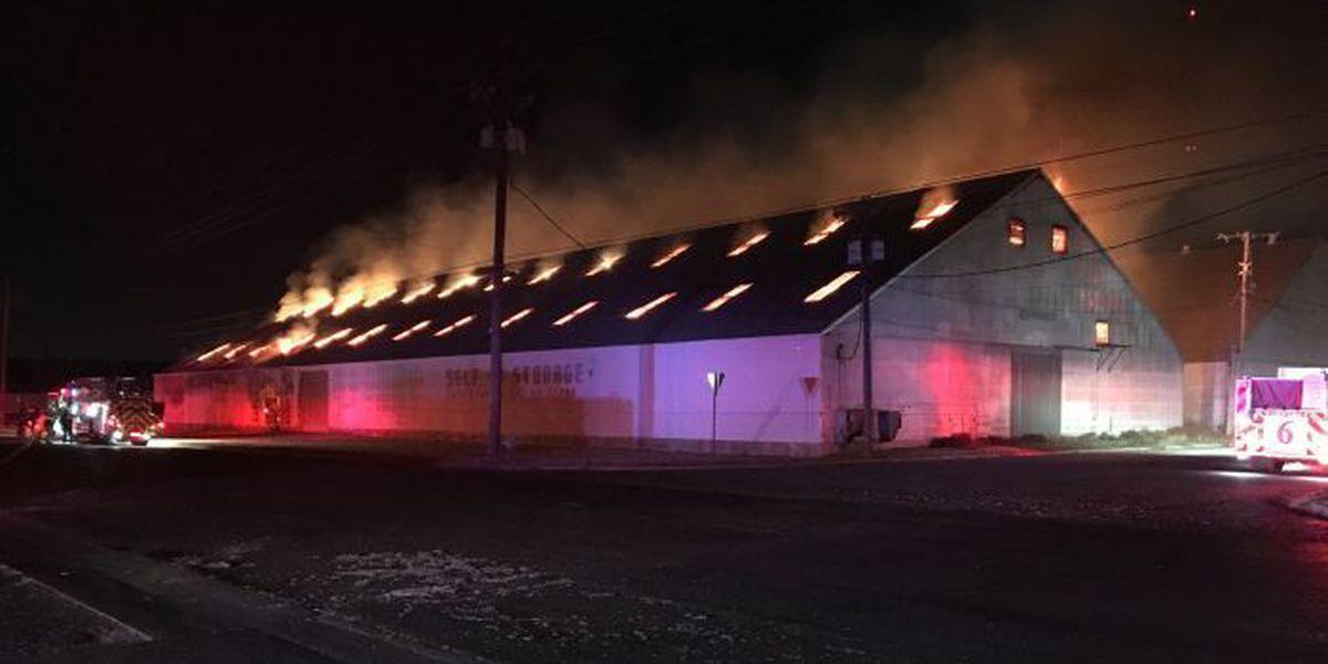 Two-alarm fire in cotton warehouse still smoldering