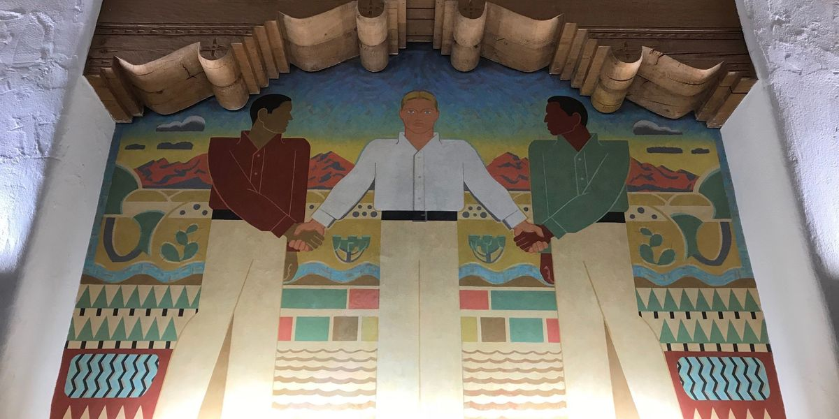 University head recommends covering controversial murals