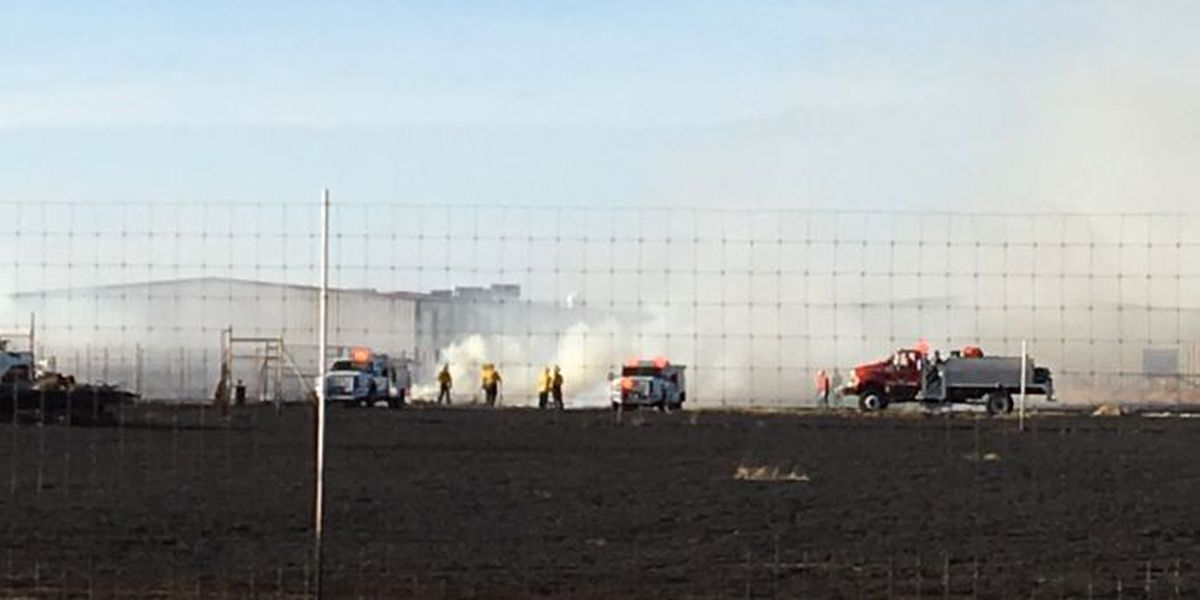 Grass fire at 1585 & Chicago 100 percent contained, 2 homes saved