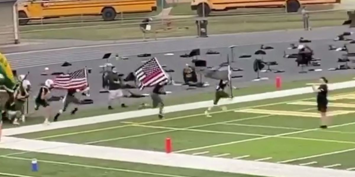 Football players' suspension lifted after carrying thin blue line, thin red line flags onto field