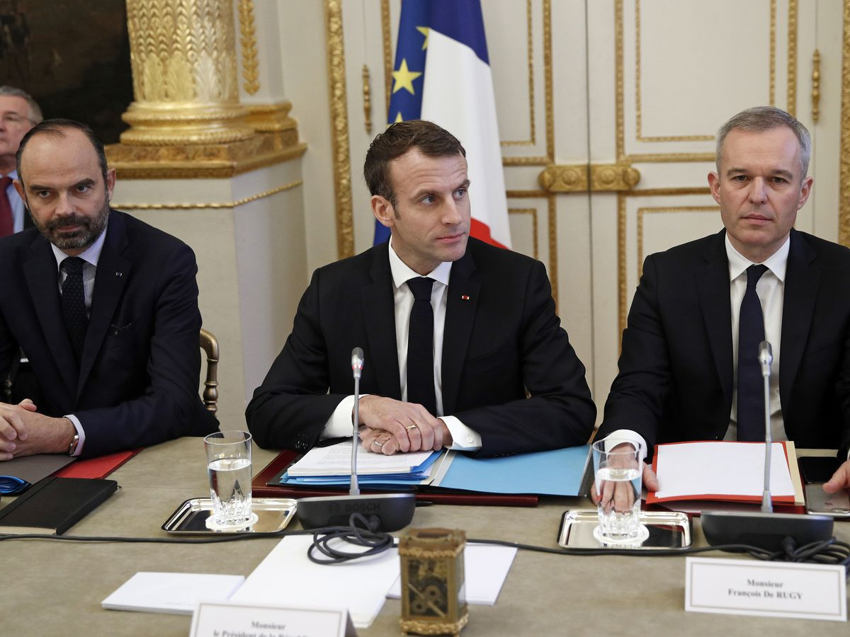 The Latest: Unions wait to hear Macron's plans for France