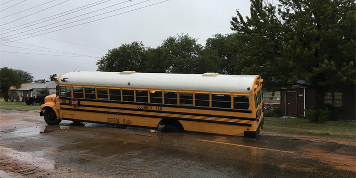 Waterline rupture causes school bus to get stuck in sinkhole