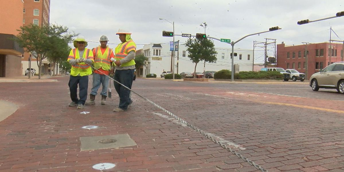 Work begins on constructing bicycle lanes down Broadway