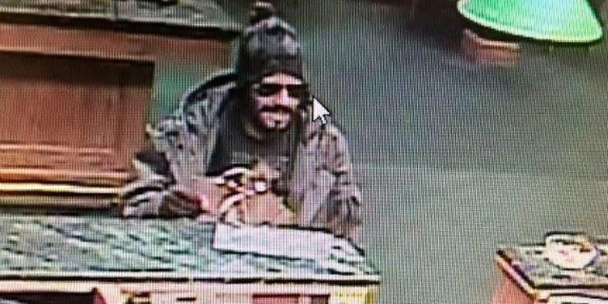 Search continues for man who dropped suspicious package during bank robbery