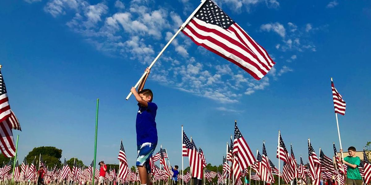 Stars and stripes fly high in Kastman Park for annual flag field