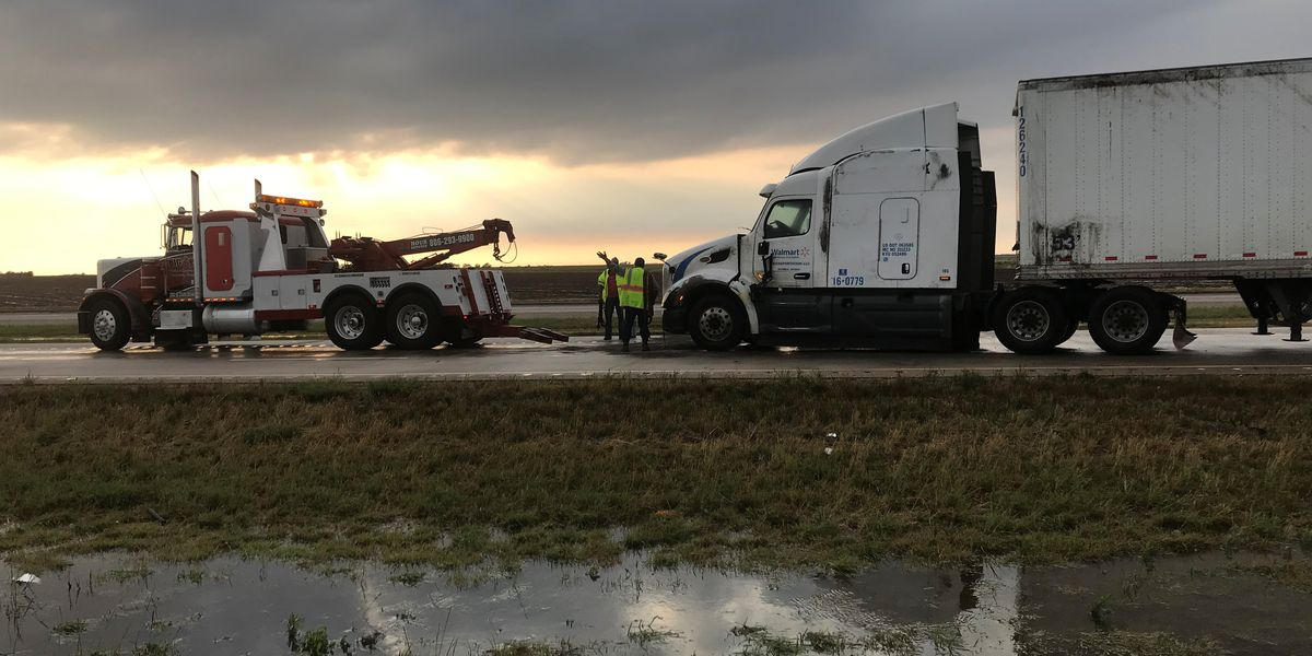 Law enforcement responds to turned over semi on I-27