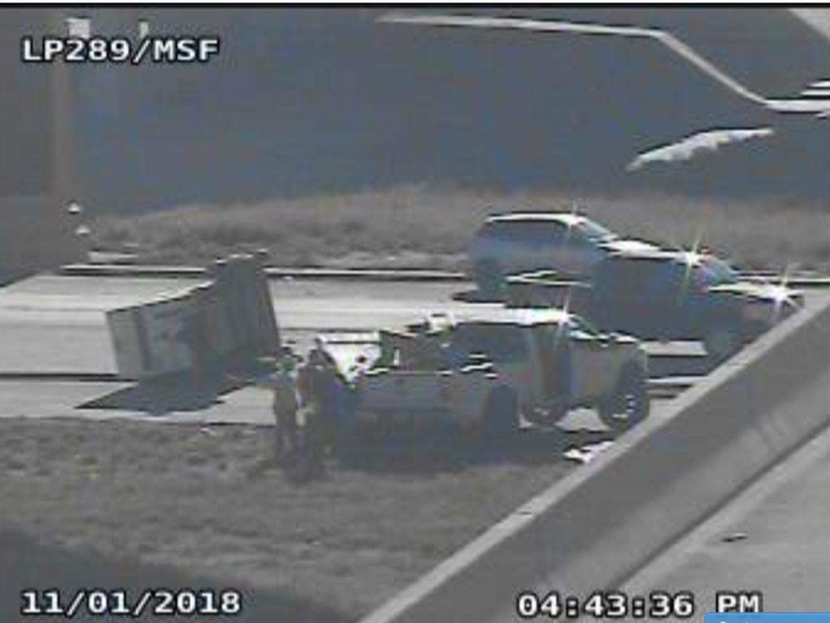Overturned trailer on northbound access road of W. Loop 289 at Marsha Sharp Freeway