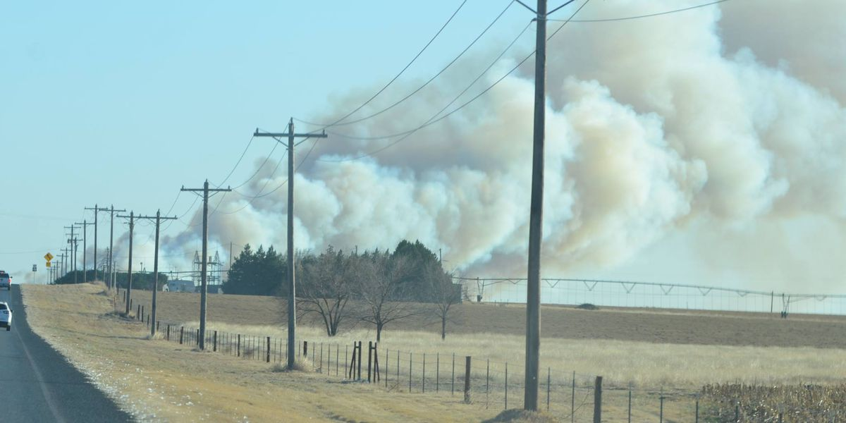 Highway closed while multiple departments respond to grass fire near Olton