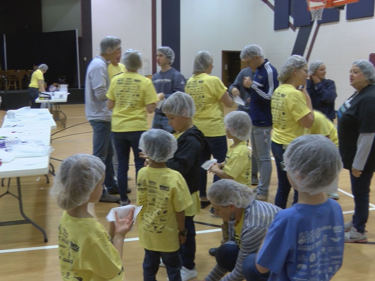 Students at Lubbock's Kingdom Prep Academy pack 10,000 meals to send to Haiti