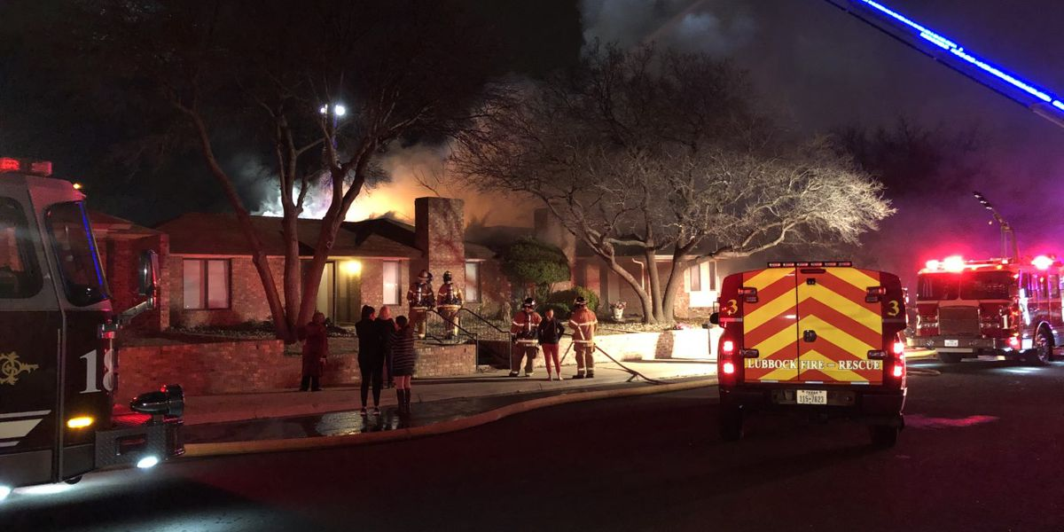 Injured woman 'critical but stable' after being pulled from house fire at 84th & Slide Road